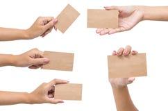 Samling av tomma kort i en hand som isoleras på vit Arkivfoton