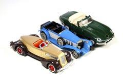 Samling av tre Toy Model Cars på vit Fotografering för Bildbyråer