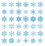 Samling av vektorn för 36 snöflingor Arkivbilder
