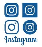 Samlingen av blåa Instagram logoer skrivev ut på papper Arkivfoton