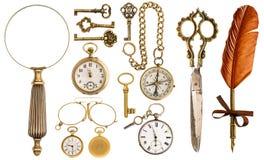 Samlingen av guld- den tappningtillbehör och antikviteten anmärker arkivfoto