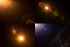 Samlingen av 4 isolerade ljusa linssignalljusläckor arkivfoton