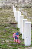 Samll americal flaggs flap in the wind at a military cemetery Royalty Free Stock Photos