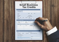 Samll Business Loan Form Tax Credits Niche Concept. Businessman Signing Agreement Contract Concept stock images