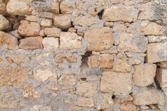 Samlles pattern of aged castle wall stone texture in the Greek town stock photo