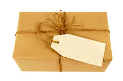 Samm paper parcel tied with string, blank manila message label, isolated on white Stock Images