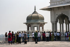 Samman Burj and Shah Jahan`s Diwan-i-khas. Agra, India - October 11, 2016: Tourists admiring and posing with Samman Burj octagonal tower and Shah Jahan`s private Royalty Free Stock Photography