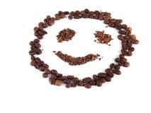 Sammansättning av kaffebönor i form av en smiley Arkivfoto