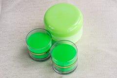 Sammansättning av 3 kosmetiska omsorgflaskor Fotografering för Bildbyråer