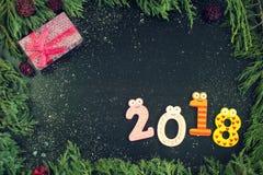 Sammansättning för nytt år med gran-träd, kottar och stearinljus Royaltyfria Foton