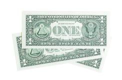 Sammansättning från en dollar räkningar som isoleras på vit arkivfoton