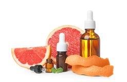 Sammansättning med nödvändig olja för grapefrukt arkivbild