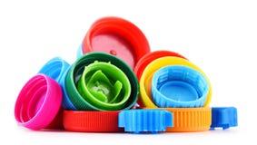 Sammansättning med plast- flasklock Fotografering för Bildbyråer