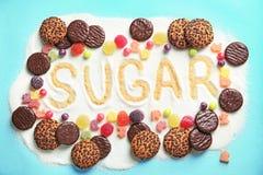 Sammansättning med socker och sötsaker arkivbild