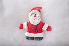 Sammansättning Santa Claus och julgran handgjort Arkivbilder