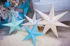 Sammansättningen av julstjärnan på en pälsfilt Royaltyfri Foto