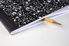 Sammansättningsanmärkningsbok och blyertspenna Royaltyfria Bilder
