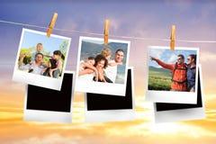 Sammansatt bild av ögonblickliga foto som hänger på en linje Royaltyfri Bild