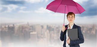 Sammansatt bild av affärskvinnan med paraplyet royaltyfri foto