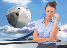 Sammansatt bild av affärskvinnan som justerar hennes exponeringsglas Royaltyfria Bilder