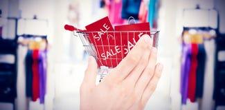 Sammansatt bild av affärsmaninnehavhanden ut i presentation Fotografering för Bildbyråer