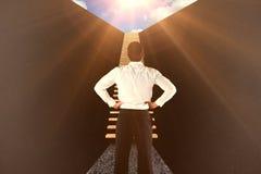 Sammansatt bild av affärsmannen som är stående tillbaka till kameran med händer på höfter 3d Royaltyfria Bilder