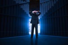 Sammansatt bild av affärsmannen som är stående tillbaka till kameran med händer på huvudet 3d Royaltyfria Bilder