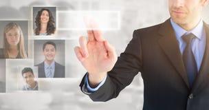 Sammansatt bild av affärsmannen som pekar dessa fingrar på kameran Fotografering för Bildbyråer