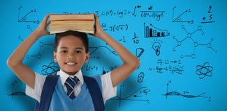 Sammansatt bild av att le bärande böcker för skolpojke på huvudet över vit bakgrund Arkivbild