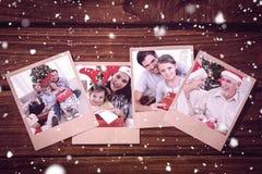 Sammansatt bild av att le lilla flickan med hennes fader som rymmer en julgåva Fotografering för Bildbyråer