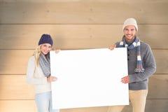 Sammansatt bild av attraktiva par i affisch för vintermodevisning Arkivbild