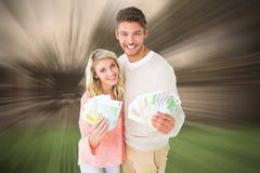 Sammansatt bild av attraktiva par som exponerar deras kassa arkivbilder