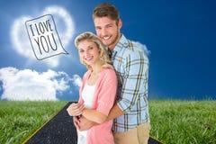 Sammansatt bild av attraktiva par som omfamnar och ler på kameran fotografering för bildbyråer