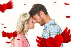 Sammansatt bild av attraktiva par som står rörande huvud Arkivfoto
