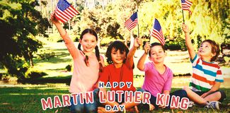 Sammansatt bild av barn som rymmer amerikanska flaggan royaltyfri fotografi