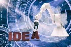 Sammansatt bild av bilden av den robotic armen som ordnar idétext 3d Arkivbild
