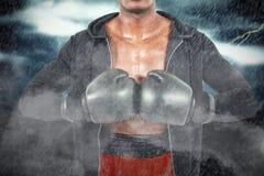 Sammansatt bild av boxaren som förbereder sig för turneringen Royaltyfri Foto