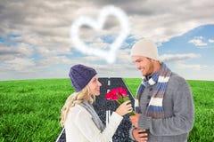 Sammansatt bild av den attraktiva mannen i erbjudande rosor för vintermode till flickvännen Royaltyfria Foton