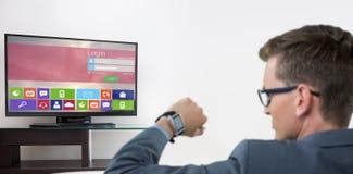 Sammansatt bild av den bakre sikten av affärsmannen som kontrollerar hans smarta klocka Fotografering för Bildbyråer