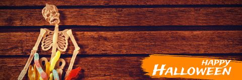 Sammansatt bild av den digitala bilden av lycklig halloween text Royaltyfria Bilder
