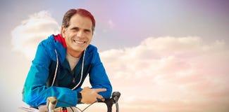 Sammansatt bild av den digitala komposit av den höga mannen med hans cykel Royaltyfria Bilder