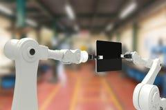 Sammansatt bild av den digitala sammansatta bilden av robotar och den digitala minnestavlan 3d Royaltyfria Foton