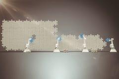 Sammansatt bild av den digitalt frambragda bilden av robotic armar som ordnar det blåa figursågstycket på pussel 3 Royaltyfri Foto