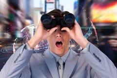 Sammansatt bild av den förvånade affärsmannen som ser till och med kikare royaltyfria bilder