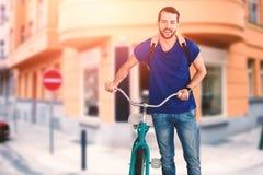 Sammansatt bild av den fulla längden av den unga mannen med cykeln Fotografering för Bildbyråer