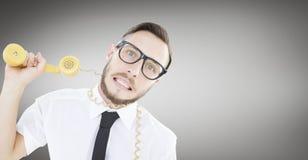 Sammansatt bild av den geeky affärsmannen som strypas av telefonkabel royaltyfri fotografi