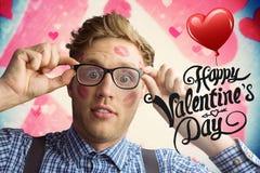 Sammansatt bild av den geeky hipsteren som täckas i kyssar Arkivbilder