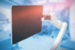 Sammansatt bild av den grafiska bilden av den digitala minnestavlan med roboten 3d Royaltyfri Foto