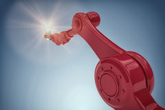 Sammansatt bild av den grafiska bilden av den hållande glödtråden 3d för robotic hand Royaltyfri Foto