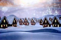 Sammansatt bild av den gulliga julbyn Arkivbilder